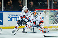 KELOWNA, CANADA - SEPTEMBER 22:  Nolan Kneen #27 blocks a shot on Dylan Ferguson #31 of the Kamloops Blazers by the Kelowna Rockets on September 22, 2018 at Prospera Place in Kelowna, British Columbia, Canada.  (Photo by Marissa Baecker/Shoot the Breeze)  *** Local Caption ***