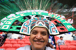 A Mexico fan wearing a headdress in the stands