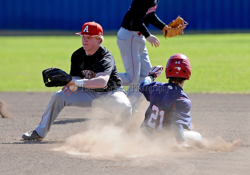 Pike Liberal Arts School's Rush Hixon (21) safely steals second base past Abbeville Christian Academy's Cody Cain during a game in Troy, Ala., Thursday, March 13, 2014. (Photo/Thomas Graning)