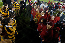 Nov 19, 2011; Stanford CA, USA;  Stanford Cardinal students (right) hold the Stanford axe in front of California Golden Bears students (left) on the sidelines during the fourth quarter at Stanford Stadium.  Stanford defeated California 31-28. Mandatory Credit: Jason O. Watson-US PRESSWIRE