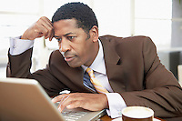 Businessman Using Laptop hand on head head and shoulders