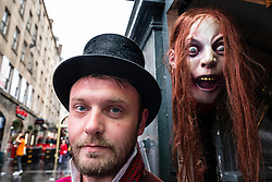 Guide and kiosk for Edinburgh's Underground ghost tours on the Royal Mile in Edinburgh, Scotland, UK