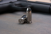 Handgun and hallow-point bullets