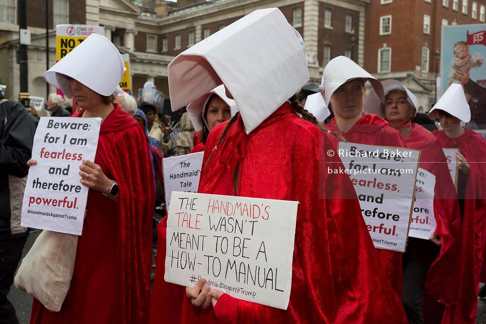 On US President Donald Trump's second day of a controversial three-day state visit to the UK, protesters in Handmaid's Tale costumes march down Whitehall and voice their opposition to the 45th American President, down Whitehall, on 4th June 2019, in London England.