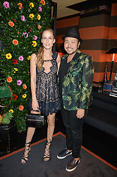 HUM FLEMING and designer ETHAN K at a private dinner for designer Ethan K held at Blakes Hotel, 33 Roland Gardens, London on 26th October 2016.