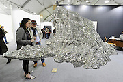 HONG KONG - MARCH 13: Visitors look at sculpture 'Impression of Hongren's Landscape' by Zheng Lu in art fair Art Central on its first day on March 13, 2015 in Hong Kong, Hong Kong.  (Photo by Lucas Schifres/Getty Images)