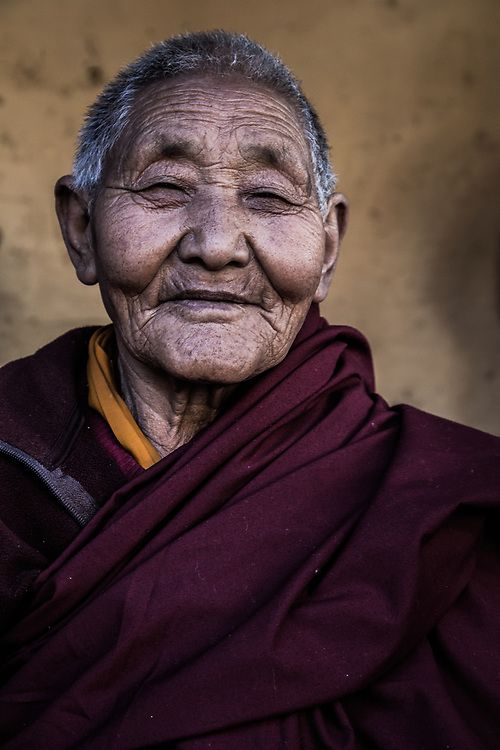 An old Tibetan lady in at a festival in Trongsa, Bhutan.