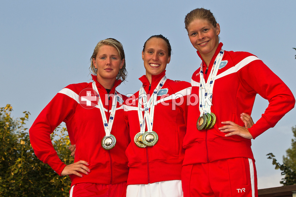 (L-R) The Danish medalist Jeanette OTTESEN, Rikke Moeller PEDERSEN and Lotte FRIIS pose with their medals after the European Swimming Championship at the Hajos Alfred Swimming complex in Budapest, Hungary, Sunday, Aug. 15, 2010. (Photo by Patrick B. Kraemer / MAGICPBK)