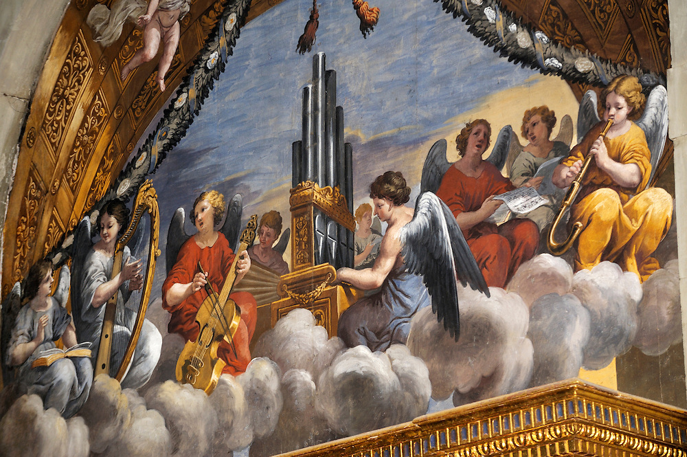 Orchestra of angels and heavenly choir mural painting in the Church of Santa Maria in Gradi. Arezzo, Tuscany, Italy