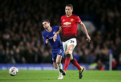 Chelsea's Jorginho (left) and Manchester United's Nemanja Matic battle for the ball during the FA Cup fifth round match at Stamford Bridge, London.