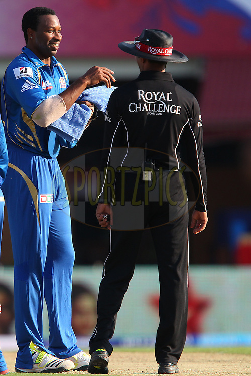 Kieron Pollard shares a light moment with the umpire during match 69 of the Pepsi Indian Premier League between The Kings XI Punjab and the Mumbai Indians held at the HPCA Stadium in Dharamsala, Himachal Pradesh, India on the on the 18th May 2013..Photo by Ron Gaunt-IPL-SPORTZPICS ..Use of this image is subject to the terms and conditions as outlined by the BCCI. These terms can be found by following this link:..http://www.sportzpics.co.za/image/I0000SoRagM2cIEc