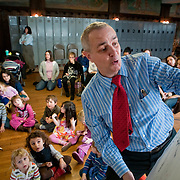 "Feb. 19, 2009 - Bronx, NY : Playwright and storyteller Jonathan Ellers of the NY Hall of Science, front, draws and narrates a story about how frogs got their legs, during a session of ""Winter Plays"" at Wave Hill on Thursday."
