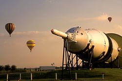 Three hot air balloons rising behind a rocket at NASA Johnson Space Center in Houston, Texas.