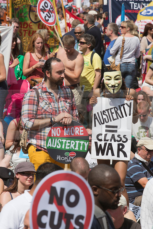 © Licensed to London News Pictures. 21/06/2014. London, England. Protesters in Parliament Square. The No More Austerity demonstration & march takes place in Central London. It was organised by the People's Assembly and it is estimated that approx. 50,000 people joined the protest. Photo credit: Bettina Strenske/LNP