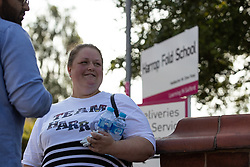 "© Licensed to London News Pictures. 19/07/2018. Salford, UK. A protester wearing a t-shirt with "" Team Harrop "" on the front . Harrop Fold School in Little Hulton is closed for a protest by parents , objecting to the outcome of a months-long investigation in to record keeping which, it is alleged, revealed that data relating to pupils' performance was embellished and which has seen the school's popular headmaster suspended from duty. Parents planned a protest following the suspension of head master Drew Povey alongside three other members of staff . The school , which has been featured in the documentary "" Educating Greater Manchester "" will remain closed throughout the day . Photo credit: Joel Goodman/LNP"