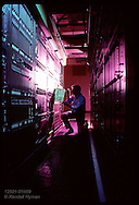 Technician pulls circuit card from switching terminal bank at Southwestern Bell in St. Louis. Missouri