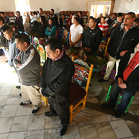 Adam Robison | BUY AT PHOTOS.DJOURNAL.COM<br /> D' Casa employees and their families gather at the West Main Street restaurant for a Ash Wednesday service given by Father Lincoln Dall of St. James Catholic Church.