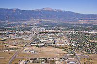 Aerial View wih Mountain range and Pikes Peak in background