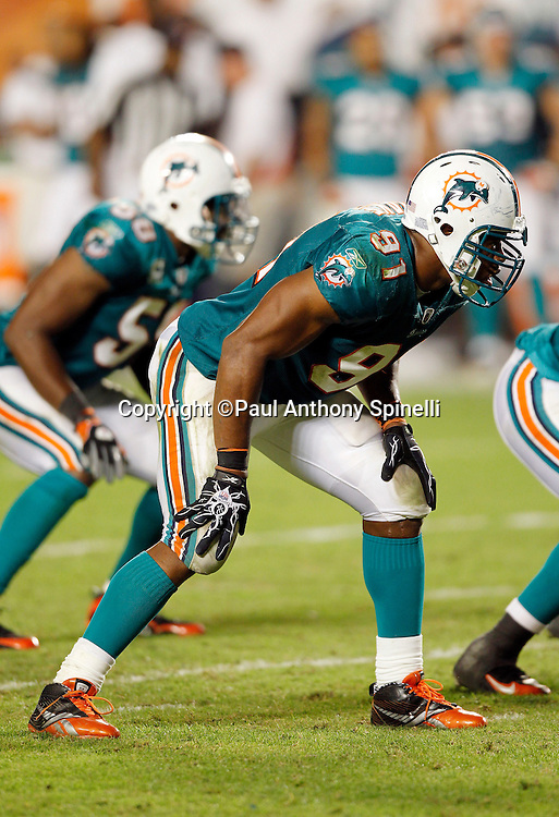 Miami Dolphins linebacker Cameron Wake (91) gets set for the snap during the NFL week 11 football game against the Chicago Bears on Thursday, November 18, 2010 in Miami Gardens, Florida. The Bears won the game 16-0. (©Paul Anthony Spinelli)