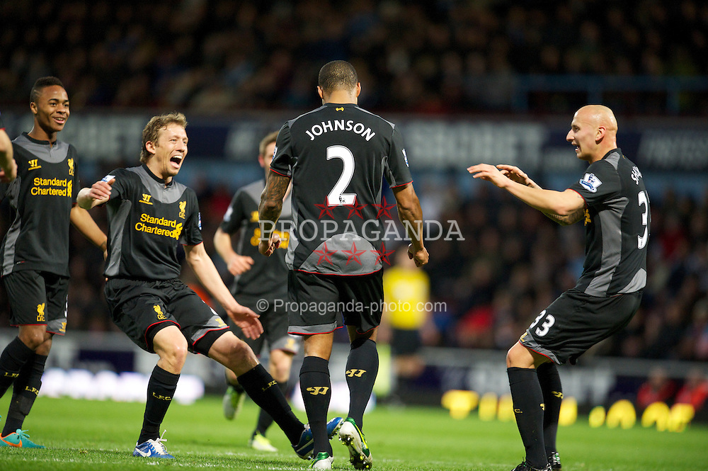 LONDON, ENGLAND - Sunday, December 9, 2012: Liverpool's Glen Johnson celebrates scoring the first goal against West Ham United with team-mates Lucas Leiva and Jonjo Shelvey during the Premiership match at Upton Park. (Pic by David Rawcliffe/Propaganda)