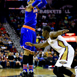Mar 28, 2016; New Orleans, LA, USA; New York Knicks forward Carmelo Anthony (7) shoots over New Orleans Pelicans guard Jrue Holiday (11) during the second quarter of a game at the Smoothie King Center. Mandatory Credit: Derick E. Hingle-USA TODAY Sports