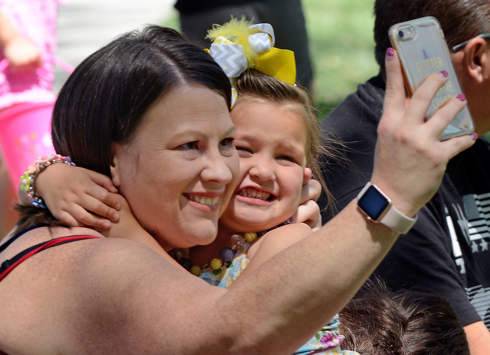 jt041517f/a sec/jim thompson/ Tara Henry and her daughter Savannah Sandoval-4 take a selfie at the Victory Outreach Albuquerque Church's HOPE Easter Egg Hunt and care Basket Giveaway at Roosevelt Park.  Saturday April 15, 2017. (Jim Thompson/Albuquerque Journal)