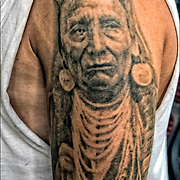 Tattoos on his shoulder of a Chief Joseph.<br /> Known as Chief Joseph or Young Joseph (March 3, 1840 &ndash; September 21, 1904), was a leader of the Wal-lam-wat-kain (Wallowa) band of Nez Perce, a Native American tribe of the interior Pacific Northwest region of the United States, in the latter half of the 19th century. He succeeded his father Tuekakas (Chief Joseph the Elder) in the early 1870s.<br /> <br /> Chief Joseph led his band of Nez Perce during the most tumultuous period in their history, when they were forcibly removed by the United States federal government from their ancestral lands in the Wallowa Valley of northeastern Oregon onto a significantly reduced reservation in the Idaho Territory. A series of violent encounters with white settlers in the spring of 1877 culminated in those Nez Perce who resisted removal, including Joseph's band and an allied band of the Palouse tribe, to flee the United States in an attempt to reach political asylum alongside the Lakota people, who had sought refuge in Canada under the leadership of Sitting Bull.