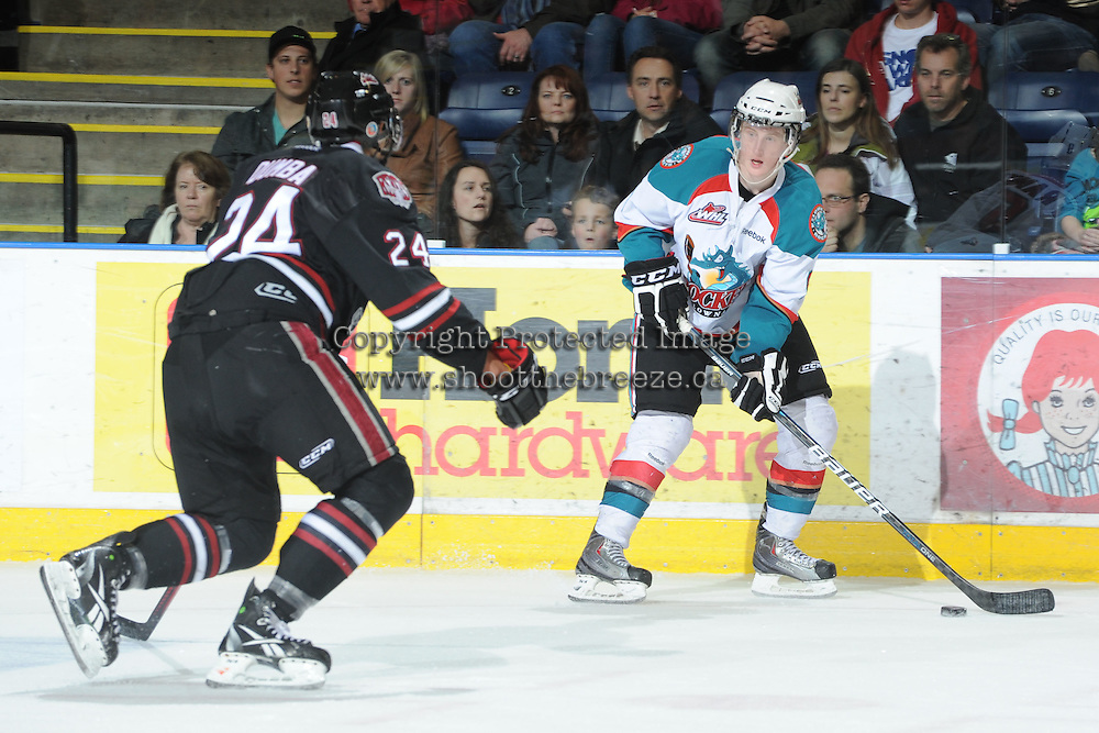 KELOWNA, CANADA - FEBRUARY 18: Zach Franko #9 of the Kelowna Rockets skates with the puck against the Red Deer Rebels at the Kelowna Rockets on February 18, 2012 at Prospera Place in Kelowna, British Columbia, Canada (Photo by Marissa Baecker/Shoot the Breeze) *** Local Caption ***