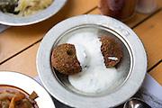 Falafel yoghurt plate at Ciya Sofrasi Turkish restaurant in Kadikoy district Asian side Istanbul, East Turkey