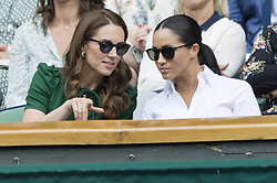 July 13, 2019 - London, London, UK - London, UK. HRH The Duchess of Cambridge and HRH The Duchess of Sussex watches the ladies singles finals on centre court tennis on Day 12 of the Wimbledon Tennis Championships 2019 held at the All England Lawn Tennis and Croquet Club. (Credit Image: © Ray Tang/London News Pictures via ZUMA Wire)