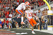 Clemson Tigers wide receiver Hunter Renfrow (13) celebrates a his touchdown with teammate Deon Cain (8) during the second half of the the National Championship game at Raymond James Stadium in Tampa.