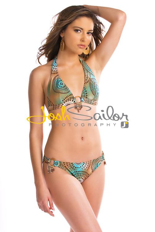 Teen model wearing a bikini swimsuit on a white background.
