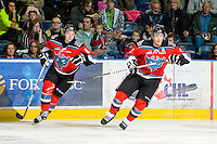 KELOWNA, CANADA, OCTOBER 20:  Colten Martin #8 and Mitchell Chapman #5 of the Kelowna Rockets skate on the ice as the Vancouver Giants visited the Kelowna Rockets on October 20, 2011 at Prospera Place in Kelowna, British Columbia, Canada (Photo by Marissa Baecker/shootthebreeze.ca) *** Local Caption ***Colten Martin; Mitchell Chapman;