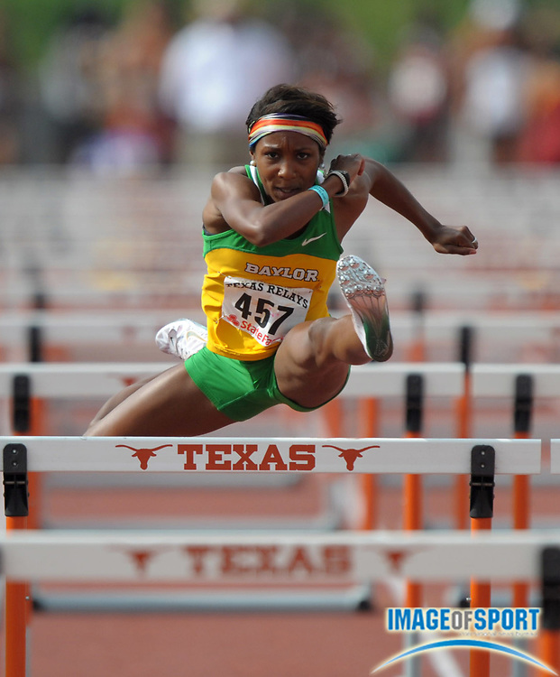 Mar 30, 2012; Austin, TX, USA; Tiffani McReynolds of Baylor runs 13.29 in a womens 100m hurdle heat in the 85th Clyde Littlefield Texas Relays at Mike A. Myers Stadium.