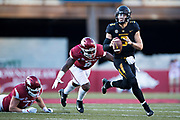 FAYETTEVILLE, AR - NOVEMBER 24:  Drew Lock #3 of the Missouri Tigers runs the ball during a game against the Arkansas Razorbacks at Razorback Stadium on November 24, 2017 in Fayetteville, Arkansas.  The Tigers defeated the Razorbacks 48-45.  (Photo by Wesley Hitt/Getty Images) *** Local Caption *** Drew Lock