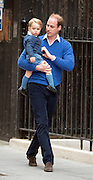 © Licensed to London News Pictures. 02/05/2015. London, UK. Prince George and Prince William.  The Duke and Duchess of Cambridge appear on the steps of the Lindo Wing at  St Mary's Hospital, Paddington, London today 2nd May 2015 with their newborn little girl. The Child will be the fourth in line to the throne. Photo credit : Stephen Simpson/LNP