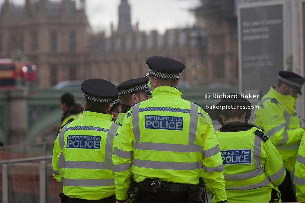 Police officers gather under the London Eye, locked-down after four people were killed (including the attacker) and 20 injured during a terrorist attack on Westminster Bridge and outside the Houses of Parliament, on 22nd March 2017, in central London, England. Parliament was in session and all MPs and staff and visitors were in lock-down while outside, the public and traffic were kept away from the area of Westminster Bridge and parliament Square, the scenes of the attack. It is believed a lone man crashed his car into pedestrians then, armed with a knife tried to enter Parliament, stabbing and killing a police officer at parliament's main gates.