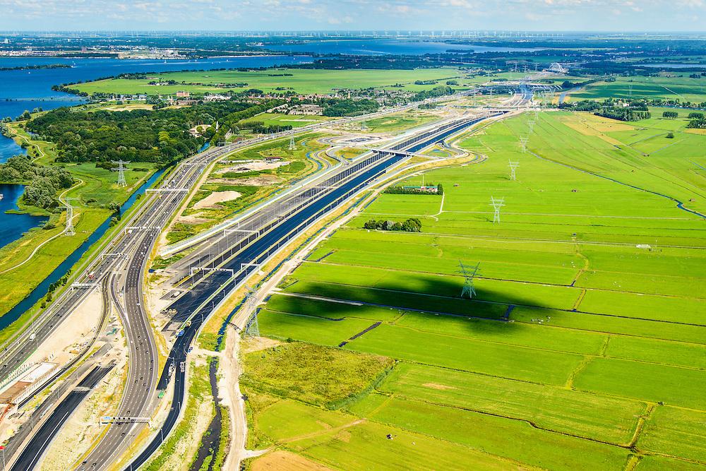Nederland, Noord-Holland, Diemen, 01-08-2016; Rijksweg A1 ter hoogte van Diemen, gezien naar Muiden en knooppunt Muiderberg. De nieuwe rijstroken van de A1 liggen klaar om aangesloten te worden op de bestaande. Medio augustus opent het nieuwe weggedeelte.<br /> The new lanes of the A1 motorway are ready to be connected to the existing one. In mid-August opens the new segment of the highway, near Amsterdam.<br /> <br /> luchtfoto (toeslag op standard tarieven);<br /> aerial photo (additional fee required);<br /> copyright foto/photo Siebe Swart