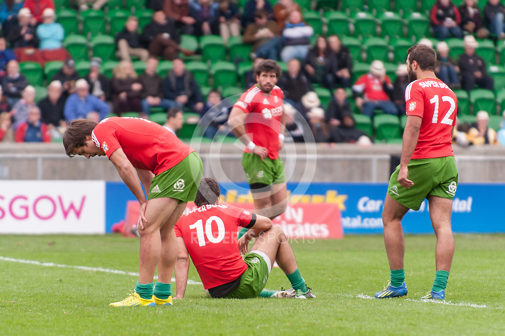 Tired Portugal players after conceding a try to Samoa. Action from the IRB Emirates Airline Glasgow 7s at Scotstoun in Glasgow. 3 May 2014. (c) Paul J Roberts / Sportpix.org.uk