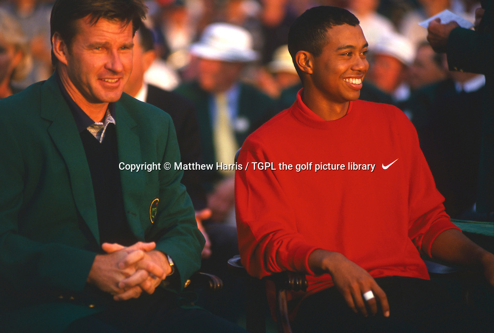 Tiger WOODS (USA) is all smiles as he is about to make history, when he will receive a famous green jacket from the 1996 champion Nick FALDO (ENG) during fourth round US Masters 1997,Augusta National, Augusta, Georgia,USA.