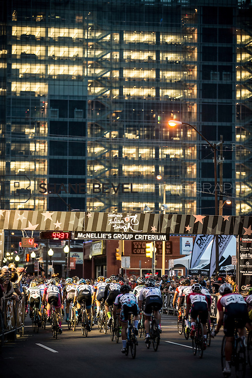 6/12/15 8:45:01 PM -- Racers pass by the crowds in the Criterium races in the Blue Dome District on Friday night of Tulsa Tough. <br /> <br /> Photo by Shane Bevel