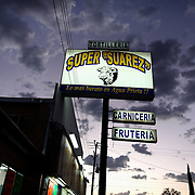 The sign for a tienda or tortilleria (supermarket/bakery) in Agua Perieta, Mexico glows under cloudy skies.