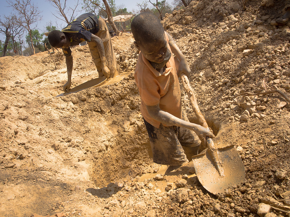 Burkina Faso has witnessed a gold boom in recent years, becoming the fourth largest producer of gold in the world. However, the increased production has also led to an increase of child laborers working in dangerous conditions in small, artisanal mines. In just a quarter century, one of the world's poorest countries has transformed itself into Africa's fourth-largest producer of gold. But at what cost to the children who labor in the mines? Landlocked, Burkina Faso is wedged between Mali and Niger to the northwest and east, and borders Ghana on the north. Although large foreign countries had mined Burkina Faso gold for almost half a century, it wasn't until the famines of the 1980s forced families off their farms that artisanal or small-scale mining took root. Since then, thousands have migrated to the gold fields, abandoning their agrarian roots to toil in the small-scale mining operations that dot the countryside.<br /> To maximize profits, entire families work. And this means putting children to work as child laborers. Gold fever shows no sign of ending. Data published in 2012 by the United States Department of Labor estimate that almost half of all children in Burkina Faso younger than 18 work. Of these, many children toil in the agriculture and mining sectors where they are exposed to chemical hazards, hazardous machinery and heavy labor.