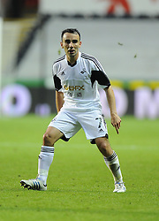 "Swansea City's Leon Britton  - Photo mandatory by-line: Joe Meredith/JMP - Tel: Mobile: 07966 386802 22/08/2013 - SPORT - FOOTBALL - Liberty Stadium - Swansea -  Swansea City V Petrolul Ploiesti - Europa League Play-Off EDITORIAL USE ONLY. No use with unauthorised audio, video, data, fixture lists, club/league logos or ""live"" services. Online in-match use limited to 45 images, no video emulation. No use in betting, games or single club/league/player publications"
