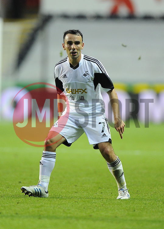 """Swansea City's Leon Britton  - Photo mandatory by-line: Joe Meredith/JMP - Tel: Mobile: 07966 386802 22/08/2013 - SPORT - FOOTBALL - Liberty Stadium - Swansea -  Swansea City V Petrolul Ploiesti - Europa League Play-Off EDITORIAL USE ONLY. No use with unauthorised audio, video, data, fixture lists, club/league logos or """"live"""" services. Online in-match use limited to 45 images, no video emulation. No use in betting, games or single club/league/player publications"""