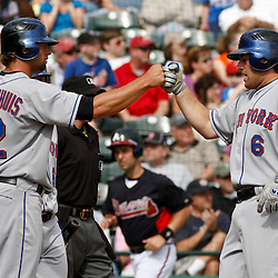 March 5, 2011; Lake Buena Vista, FL, USA; New York Mets center fielder Kirk Nieuwenhuis (72) and left fielder Nick Evans (6) celebrate after scoring during a spring training exhibition game against the Atlanta Braves at Disney Wide World of Sports complex.  Mandatory Credit: Derick E. Hingle