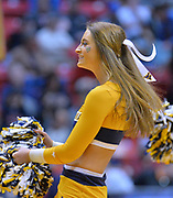 SAN DIEGO, CA - MARCH 16:  A West Virginia Mountaineers cheerleader performs during a first round game of the Men's NCAA Basketball Tournament against the Murray State Racers at Viejas Arena in San Diego, California. West Virginia won 85-68.  (Photo by Sam Wasson)