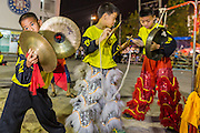09 FEBRUARY 2014 - HAT YAI, SONGKHLA, THAILAND:  Members of a lion dance troupe play drums and gongs during Lunar New Year in the Tong Sia Siang Tueng temple in Hat Yai. Hat Yai was originally settled by Chinese immigrants and still has a large ethnic Chinese population. Chinese holidays, especially Lunar New Year (Tet) and the Vegetarian Festival are important citywide holidays.     PHOTO BY JACK KURTZ
