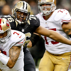 Nov 17, 2013; New Orleans, LA, USA; New Orleans Saints defensive end Akiem Hicks (76) sacks San Francisco 49ers quarterback Colin Kaepernick (7) during the first half of a game at Mercedes-Benz Superdome. Mandatory Credit: Derick E. Hingle-USA TODAY Sports