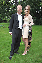 The HON.JUSTIN PORTMAN and NATALIA VODIANOVA at the Raisa Gorbachev Foundation fourth annual fundraising gala dinner held at Stud House, Hampton Court, Surrey on 6th June 2009.